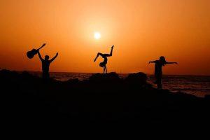 yoga group sunset